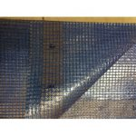 Transparent reinforced tarpaulins